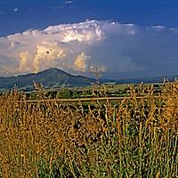 MONTANA. Summer thunderstorm builds over Bridger Mountains. Bozeman and Gallatin Valley fgnd.