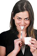 Young woman enjoys a spoon of yogurt