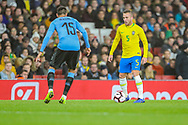 Brazil midfielder Arthur (5) and Uruguay midfielder Matías Vecino (15) during the Friendly International match between Brazil and Uruguay at the Emirates Stadium, London, England on 16 November 2018.