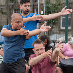 At the end of their week long Essence training course in Edinburgh, Movement in Worship participants brought their drums, flags and spiritual-based movements down to Portobello Prom this morning. The participants, who have come from all over the UK and beyond, performed a number of improvised pieces of music and movement between the showers. © Jon Davey/ EEm