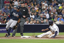 June 28, 2017 - San Diego, CA, USA - The San Diego Padres' Manuel Margot steals third base as the Atlanta Braves' Johan Camargo can only watch during the third inning at Petco Park in San Diego on Wednesday, June 28, 2017. (Credit Image: © Hayne Palmour Iv/TNS via ZUMA Wire)