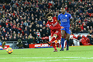 Mohamed Salah of Liverpool (r) shoots and scores his teams 1st goal to make it 1-1. Premier League match, Liverpool v Leicester City at the Anfield stadium in Liverpool, Merseyside on Saturday 30th December 2017.<br /> pic by Chris Stading, Andrew Orchard sports photography.