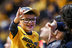 Jan 20, 2018; Morgantown, WV, USA; A young West Virginia Mountaineers fan celebrates during the second half against the Texas Longhorns at WVU Coliseum. Mandatory Credit: Ben Queen-USA TODAY Sports