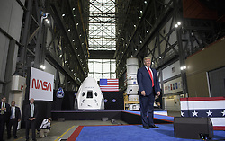 In this photo released by the National Aeronautics and Space Administration (NASA), President Donald Trump speaks inside the Vehicle Assembly Building following the launch of a SpaceX Falcon 9 rocket carrying the company's Crew Dragon spacecraft on NASA's SpaceX Demo-2 mission with NASA astronauts Robert Behnken and Douglas Hurley onboard, Saturday, May 30, 2020, at NASA's Kennedy Space Center in Florida. NASA's SpaceX Demo-2 mission is the first launch with astronauts of the SpaceX Crew Dragon spacecraft and Falcon 9 rocket to the International Space Station as part of the agency's Commercial Crew Program. The test flight serves as an end-to-end demonstration of SpaceX's crew transportation system. Behnken and Hurley launched at 3:22 p.m. EDT on Saturday, May 30, from Launch Complex 39A at the Kennedy Space Center. A new era of human spaceflight is set to begin as American astronauts once again launch on an American rocket from American soil to low-Earth orbit for the first time since the conclusion of the Space Shuttle Program in 2011. Photo by Bill Ingalls / NASA via CNP/ABACAPRESS.COM