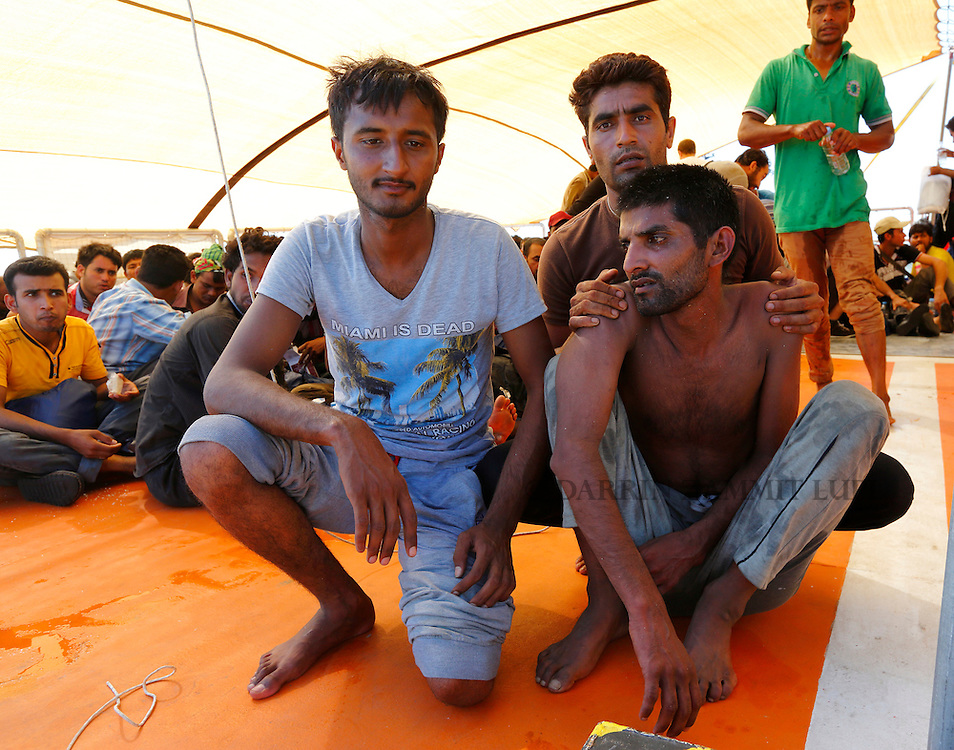 Migrants rest on the upper deck of the Migrant Offshore Aid Station (MOAS) ship MV Phoenix after being rescued from an overloaded wooden boat 10.5 miles (16 kilometres) off the coast of Libya August 6, 2015.  An estimated 600 migrants on the boat were rescued by the international non-governmental organisations Medecins san Frontiere (MSF) and MOAS without loss of life on Thursday afternoon, according to MSF and MOAS, a day after more than 200 migrants are feared to have drowned in the latest Mediterranean boat tragedy after rescuers saved over 370 people from a capsized boat thought to be carrying 600.<br /> REUTERS/Darrin Zammit Lupi <br /> MALTA OUT. NO COMMERCIAL OR EDITORIAL SALES IN MALTA