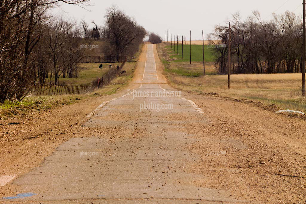"""Old US Route 66 south of Miami Oklahoma. An Original alignment consisting of Portland Cement less than15 feet wide here, sometimes refered to as """"Sidewalk Highway"""". This is just south of the 8' wide section. Location E 130 Rd, View East."""