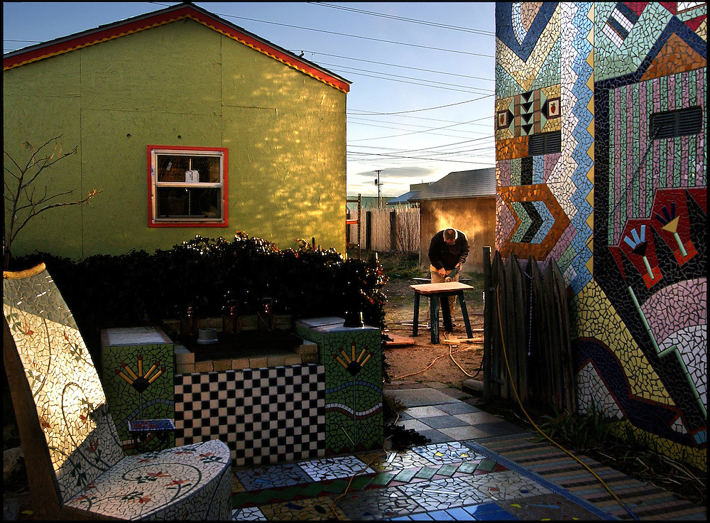 """Steven St. John/Tribune       2005.01.29..Kyle Ray grinds flagstone in the back yard of the """"tile house"""" on Friday evening, January 29, 2004. ((NOTE:Kyle Ray married to Erin Magennis)).."""
