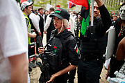 A member of the Huey P. Newton Gun Club carries a rifle while protesting against the KKK. Hundreds of counter protesters, including the Nation of Islam, New Black Panthers, and Huey Newton Gun Club, American Indian Movement, and ANTIFA gathered in downtown Dayton, Ohio to protest members of the Honorable Sacred Knights - a Ku Klux Klan group from Indiana. There were no arrests, and the protests ended peacefully as hundreds of police worked to keep the event peaceful and the protesters separated. Much of downtown Dayton was shutdown, and the courthouse square, where the KKK gathered, was surrounded by fence. Members of the KKK were given a police escort to the site, where about a dozen of them gathered, and then a police escort to safety.