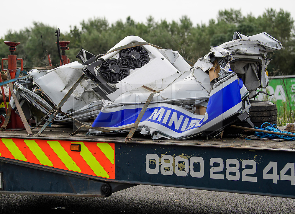 © Licensed to London News Pictures. FILE PICTURE. 26/08/2017. Remains of the minibus on the M1 motorway near Newport Pagnell following a crash involving a minibus and two lorries. The trial of Ryszard Masierak and David Wagstaff is due to start at Reading Crown Court today (Thurs). The pair are accused of causing death by dangerous driving of six men and two women who were traveling in a minibus near Newport Pagnell on 26 August. Photo credit: Ben Cawthra/LNP