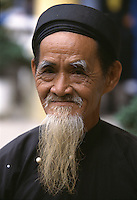 """Old man in traditional dress, Hoi An, Vietnam<br /> Available as Fine Art Print in the following sizes:<br /> 08""""x12""""US$   100.00<br /> 10""""x15""""US$ 150.00<br /> 12""""x18""""US$ 200.00<br /> 16""""x24""""US$ 300.00<br /> 20""""x30""""US$ 500.00"""