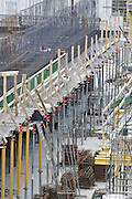 Construction scaffolds erected on a building .