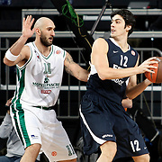 Efes Pilsen's Kerem GONLUM (R) Montepaschi Siena's Milovan RAKOVIC (L) during their Turkish Airlines Euroleague Basketball Top 16 Group G Game 1 match Efes Pilsen between Montepaschi Siena at Sinan Erdem Arena in Istanbul, Turkey, Wednesday, January 19, 2011. Photo by TURKPIX