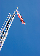 Vertical of American flag on top of ladder<br />