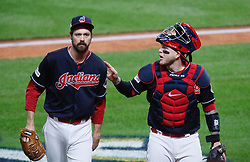 October 11, 2017 - Cleveland, OH, USA - Cleveland Indians reliever Andrew Miller gets a pat on the back from Jose Ramirez after the fourth inning against the New York Yankees during Game 5 of the American League Division Series, Wenesday, Oct. 11, 2017, at Progressive Field in Cleveland. (Credit Image: © Leah Klafczynski/TNS via ZUMA Wire)