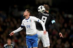 Italy's Filho Jorge Jorginho (left) and Argentina's Gonzalo Higuain (right) battle for the ball