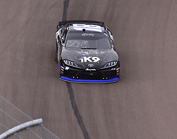 March 9, 2019 - Phoenix, Arizona, U.S. - PHOENIX, AZ - MARCH 09:  Winner of the race Kyle Busch (18) Extreme Concepts/iK9 Toyota heads for checkered flag at the NASCAR Xfinity iK9 Service Dog 200 race on March 09, 2019 at ISM Raceway in Phoenix, AZ.  (Photo by Lyle Setter/Icon Sportswire) (Credit Image: © Lyle Setter/Icon SMI via ZUMA Press)