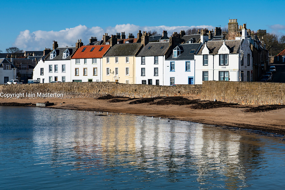 Row of historic old houses on waterfront  of harbour at Anstruther in East Neuk of Fife, Scotland, UK