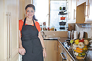 """Sabrina Ghayour, author of the """"Persiana"""" cookbook, in her London kitchen<br /> CREDIT: Vanessa Berberian for The Wall Street Journal<br /> IMK.OD"""