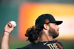 Oct 7, 2021; San Francisco, CA, USA; San Francisco Giants infielder Brandon Crawford throws with a teammate during NLDS workouts. Mandatory Credit: D. Ross Cameron-USA TODAY Sports
