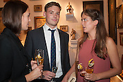 Esme Toler (left), Harry Padfield (centre) and Dorcas Kiernan (right) at the Opening of The LAPADA  Art and Antiques Fair. Berkeley Sq. London. 24 September 2013.