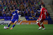 AFC Wimbledon midfielder Alex Woodyard (4) passing the ball during the EFL Sky Bet League 1 match between AFC Wimbledon and Gillingham at Plough Lane, London, United Kingdom on 23 February 2021.