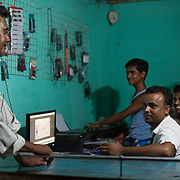 CAPTION: Shahjahan Mobile Plaza, a recent convert from diesel to energy derived from biomass by DESI Power, is able to provide computing and mobile-related services late into the night. LOCATION: Bara, Araria District, Bihar, India. INDIVIDUAL(S) PHOTOGRAPHED: From left to right - Mohammad Mahboob Alam, Babloo, Imran Alam, Rafiq Alam and Mohammad Kainan Alam.