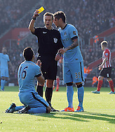 Referee Mike Jones gives Sergio Aguero of Manchester City a yellow card for diving<br /> - Barclays Premier League - Southampton vs Manchester City - St Mary's Stadium - Southampton - England - 30th November 2014 - Pic Robin Parker/Sportimage
