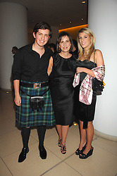 Centre, KIRSTY WARK and her children JAMES CLEMENTS and CAITLIN CLEMENTS at 'Not Another Burns Night' in association with CLIC Sargebt and Children's Hospice Association Scotland held at ST.Martins Lane Hotel, London on 3rd March 2008.<br /><br />NON EXCLUSIVE - WORLD RIGHTS