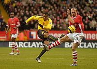Photo: Glyn Thomas.<br />Charlton Athletic v Arsenal. The Barclays Premiership.<br />26/12/2005.<br />Arsenal's Gilberto shoots as Danny Murphy (R) takes evasive action.