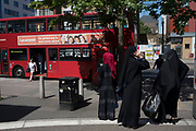 People from various ethnic backgrounds, particularly from the Muslim community around the market on Watney Street in Shadwell, East London, United Kingdom. This area in the Tower Hamlets is predominantly Muslim with over 50% of Bangladeshi descent. This is known as a very Asian and multi cultural part of Londons East End.