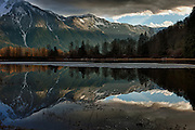 Canada, British Columbia, Agassiz, Seabird Island Road, storm clearing over mountains at sunset, Digital Composite, HDR