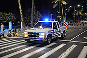 Vehicle of the D.A.R.E. Hawaii program (Drug Abuse Resistance Education) in street parade. Waikiki, Hawaii
