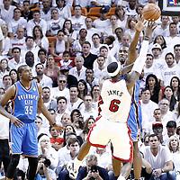 21 June 2012: Oklahoma City Thunder power forward Serge Ibaka (9) blocks Miami Heat small forward LeBron James (6) during the Miami Heat 121-106 victory over the Oklahoma City Thunder, in Game 5 of the 2012 NBA Finals, at the AmericanAirlinesArena, Miami, Florida, USA. The Miami Heat wins the series 4-1.