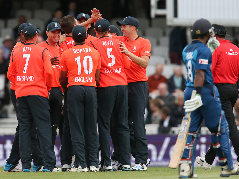 Englans's Harry Gurney celebrates his first wicket ofSri Lanka's Tillakaratne Dilshan<br /> <br /> Photographer Kieran Galvin/CameraSport<br /> <br /> International Cricket - 2014 NatWest International T20 - England v Sri Lanka - Tuesday 20th May 2014 - The Kia Oval - London<br /> <br /> © CameraSport - 43 Linden Ave. Countesthorpe. Leicester. England. LE8 5PG - Tel: +44 (0) 116 277 4147 - admin@camerasport.com - www.camerasport.com