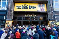 Peoplethe  queue to enter The Playhouse  Theatre in Edinburgh to see The Lion King show, Scotland, UK