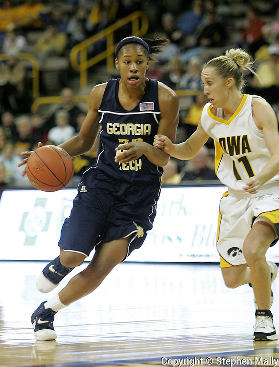 28 NOVEMBER 2007: Georgia Tech forward Alex Montgomery (22) drives to the basket while being guarded by Iowa guard Kristi Smith (11) in the second half of Georgia Tech's 76-57 win over Iowa in the Big Ten/ACC Challenge at Carver-Hawkeye Arena in Iowa City, Iowa on November 28, 2007.