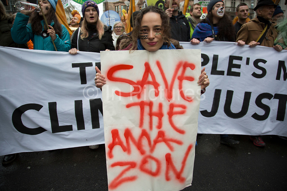 London, UK. Sunday 29th November 2015. Peoples March for Climate Justice and Jobs demonstration. Demonstrators gathered in their tens of thousands to protest against all kinds of environmental issues such as fracking, clean air, and alternative energies, prior to Major climate change talks. A woman calls to Save the Amazon
