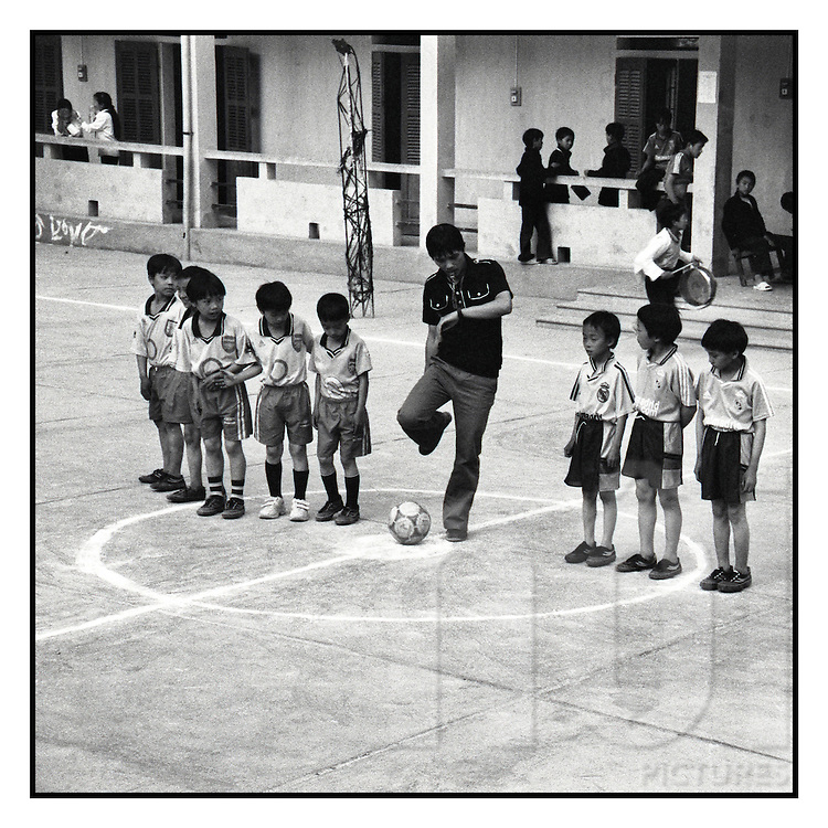 Kids line up for a school yard soccer game, Dong Van City, Northern Vietnam, Southeast Asia