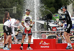 11.09.2011, Madrid,  ESP, LA VUELTA 2011, Finish, im Bild Juan Jose Cobo (c) celebrates the victory in La Vuelta 2011 with Bradley Wiggins, Second place (l) and Christopher Froome, third place (r).September 11,2011. EXPA Pictures © 2011, PhotoCredit: EXPA/ Alterphoto/ Paola Otero +++++ ATTENTION - OUT OF SPAIN/(ESP) +++++