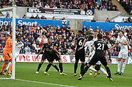 Alfie Mawson of Swansea city gets to a header but puts it wide of goal. Premier league match, Swansea city v Newcastle Utd at the Liberty Stadium in Swansea, South Wales on Sunday 10th September 2017.<br /> pic by  Andrew Orchard, Andrew Orchard sports photography.