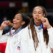 TOKYO, JAPAN August 8:  A'ja Wilson #9 of the United States and Brittney Griner #15 of the United States with their gold medals at the medal presentation after the Japan V USA basketball final for women at the Saitama Super Arena during the Tokyo 2020 Summer Olympic Games on August 8, 2021 in Tokyo, Japan. (Photo by Tim Clayton/Corbis via Getty Images)