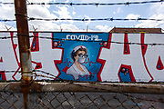 A COVID-19 mural by artist Milton Coronado in Logan Square on Thursday, April 9, 2020 during the coronavirus pandemic. His wife, Celia Coronado, is a nurse and was the inspiration for the work. (Brian Cassella/Chicago Tribune)