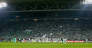 Saint-Etienne fans behind the goal with flags and scarves during the Europa League match between Saint-Etienne and Manchester United at Stade Geoffroy Guichard, Saint-Etienne, France on 22 February 2017. Photo by Phil Duncan.