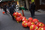 Chinese workmen pull along a snake of paper lanterns during preparations in London's Chinatown for the mid-Autumn (also Lantern or Moon) Festival where paper lanterns are to hang. The Mid-Autumn Festival, also known as the Moon Festival or Zhongqiu Festival is a popular harvest festival celebrated by Chinese, Korean, and Vietnamese people, dating back over 3,000 years to moon worship in China's Shang Dynasty. In Malaysia, Singapore, and the Philippines, it is also sometimes referred to as the Lantern Festival or Mooncake Festival. The Mid-Autumn Festival is held on the 15th day of the eighth month in the Chinese calendar, which is in September or early October in the Gregorian calendar. It is a date that parallels the autumnal equinox of the solar calendar, when the moon is at its fullest and roundest.