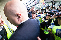 © Licensed to London News Pictures . 27/09/2018 . London , UK . TOMMY ROBINSON arrives at the Old Bailey ahead of the start of his retrial . Supporters of and those against former EDL leader Tommy Robinson (real name Stephen Yaxley-Lennon ) outside the Old Bailey , as Robinson faces a retrial for Contempt of Court following his actions outside Leeds Crown Court in May 2018 . Robinson was already serving a suspended sentence for the same offence when convicted in May and served time in jail as a consequence , but the newer conviction was quashed by the Court of Appeal and a retrial ordered . Photo credit: Joel Goodman/LNP