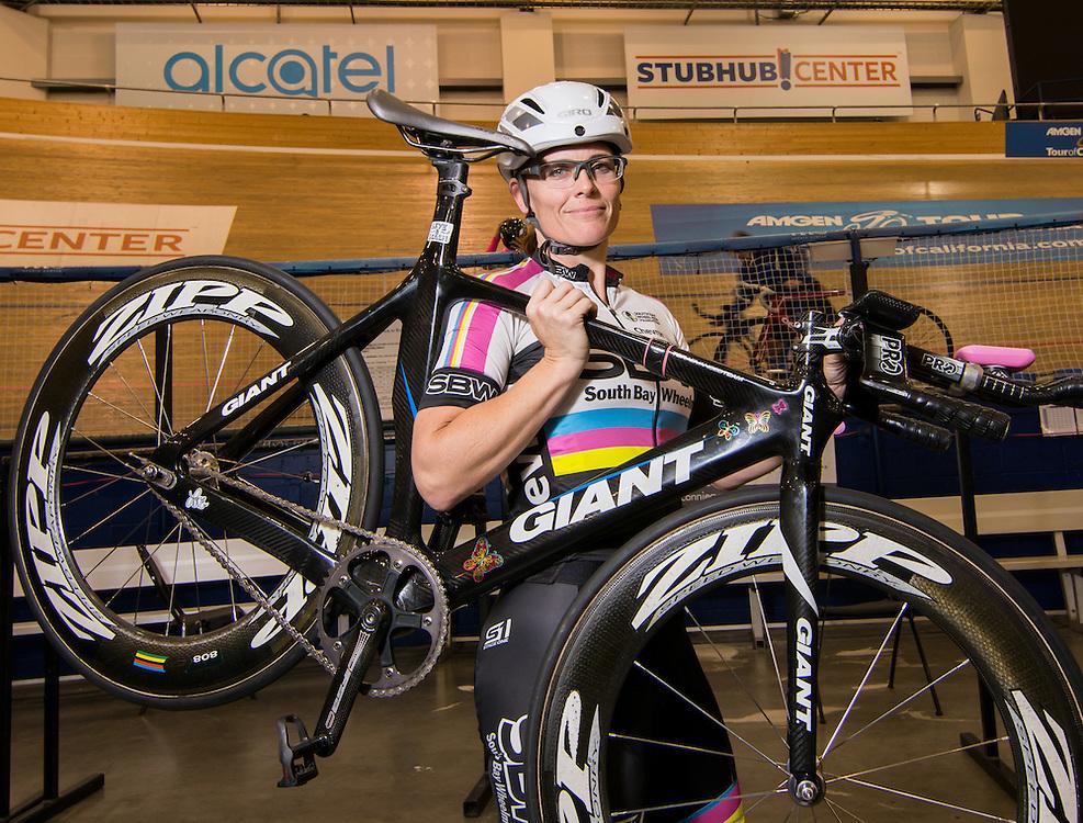 Carson, California --  Elise Taylor lifts  her bike as she prepares for practice at the Stubhub Velodromne Center
