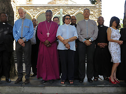Wednesday 2nd October 2016.<br /> St. George's Cathedral,<br /> Cape Town,<br /> Western Cape,<br /> South Africa.<br /> <br /> #SaveSouthAfrica Silent Prayer Vigil In Cape Town!<br /> <br /> The Most Reverend Dr. Thabo Makgoba (2nd from left) and other Religious Leaders stand together in silent protest on the steps of St. George's Cathedral in Cape Town.<br /> <br /> Concerned Religious Leaders and other South Africans gathered together in silent protest in support of the call to #SaveSouthAfrica from 'the acute social crisis that has been brought about by corruption, mismanagement and political intrigue' as reported nationwide in the news. The campaign was formed under the banner of holding government leaders accountable to the Constitution and the values they have pledged to uphold as representatives of the people. The #SaveSouthAfrica Silent Prayer vigil was held at St. George's Cathedral in Cape Town, South Africa on Wednesday 2nd November 2016.<br /> <br /> Picture By:  Mark Wessels / RealTime Images.