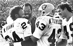 Oakland Raiders congratulate Willie Brown #24, after intercepting pass and run for TD against the Vikings in the Super Bowl. George Atkinson and Mike Siani. <br />(1977 photo./Ron Riesterer)