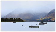 Pleasure craft on Jackson Lake following a stormy morning at Grand Teton National Park, Wyoming, USA