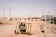 A remote police roadblock landscape near Bagdad, Kharga Oasis, Western Desert, Egypt. The desert lies in the New Valley Governorate, 350 km (220 mi.) and measures approximately 80 km (50 mi) from east to west and 25 km (16 mi) from north to south and is patrolled by armed police convoys.